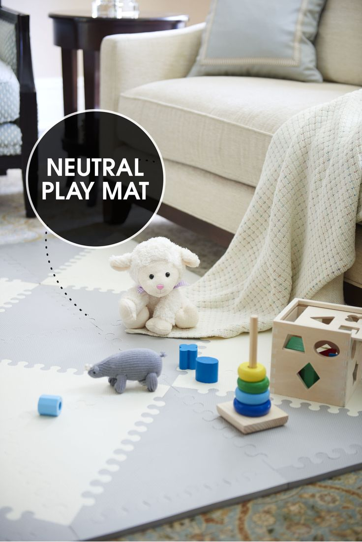 Move the coffee table aside and give your newest addition room to roam. A diamond-patterned play mat (made of interlocking foam tiles) feels plush beneath crawling hands and knees and provides traction for toddling feet. Its neutral color blends in with the other living room accessories. Skip Hop foam floor tiles, skiphop.com; knit rhino rattle, estella-nyc.com; other toys, melissaanddoug.com   - ELLEDecor.com