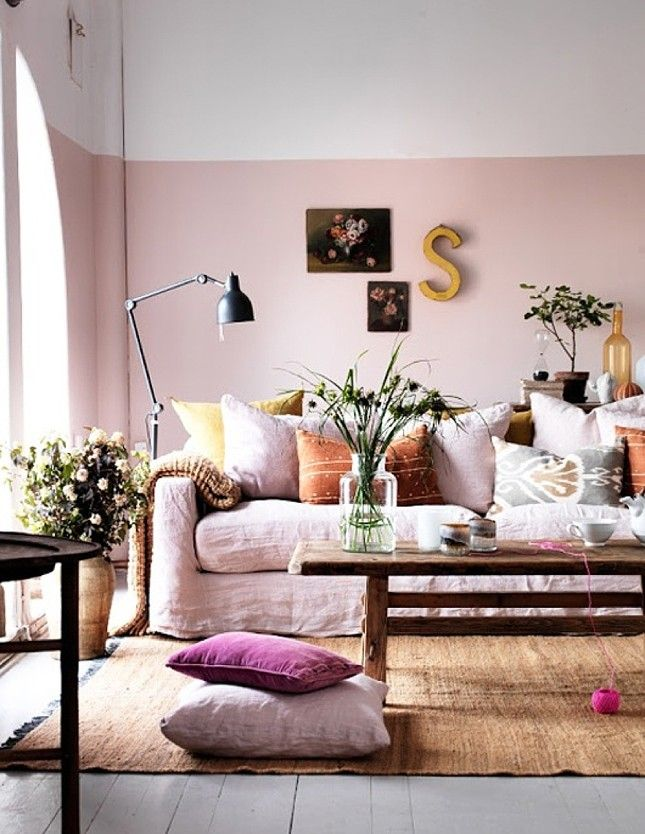 Mixing a relaxed piece of furniture with modern elements like color-blocked paint creates a great balance.
