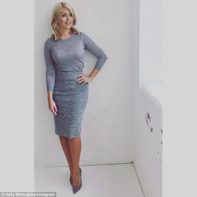 Dressed to impress: Holly donned a simple yet sophisticated grey ensemble featuring a lady...