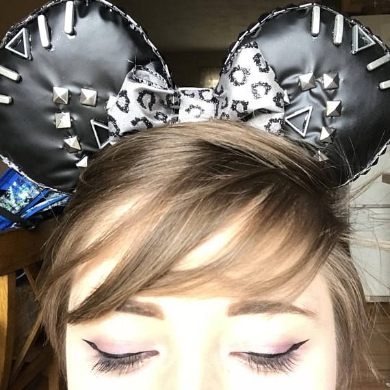 Inspired by the King of Wakanda: Black Panther! These are high quality, comfortable ears are reversible, cute, sparkly, and great for long park wear! They are covered in embellishments and have grommets hammered in to one side. Because of all of these embellishments, these ears are