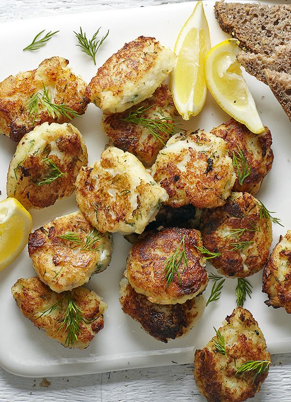 Smoked Cod Fritters: Spanish tapas classic made easy. Bite-sized smoked cod and potato fishcakes bound together with egg and flour then quickly fried until crispy. Serve with lemon wedges.