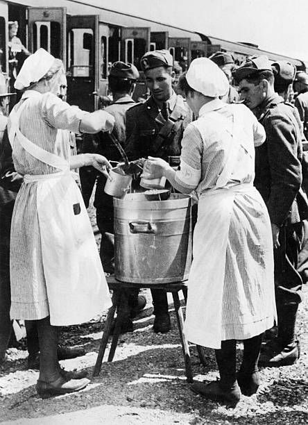 German Red Cross nurses distributing mess rations to the Italian Expeditionary Corps in Russia travelling towards Ukraine. July 1941 - pin by Paolo Marzioli