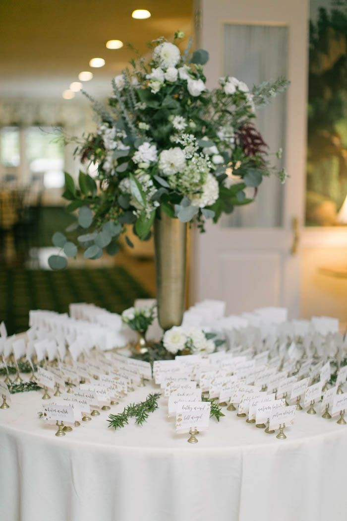 wedding table name card size%0A Elegant white and gold escort card table decor   Image by AGPcollective
