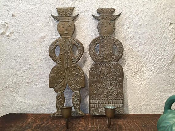 On #QuirkySunday we bring you a rare pair of #bronze wall #candlesticks of hats carrying couple to make U :) or wonder