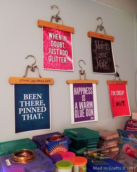 Love these craft quotes on hangers for craft room wall art. See the whole craft room at madincrafts.com