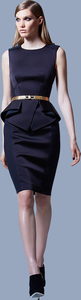 This outfit is an example of Emphasis because your eyes are drawn to her waist. She has vertical and diagonal lines. The belt also draws your eyes because of the color.