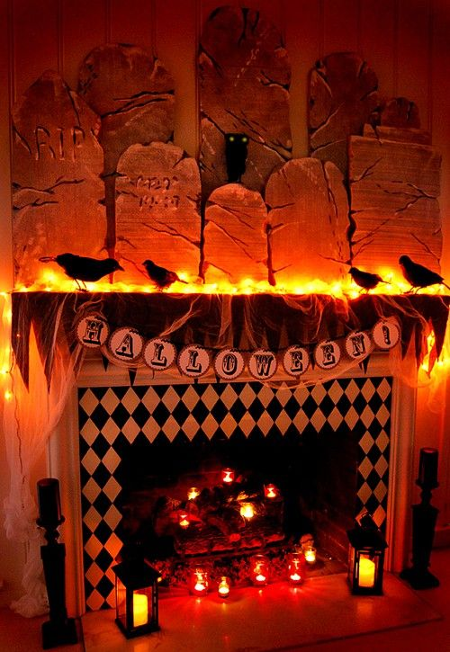 orange lights behind the fireplace to add a festive look to the other decorations for halloween