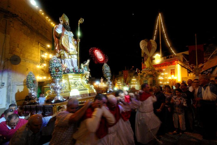 """Festa San Nikola, (2009) The procession is close to its end. I think this photo is summary of what festas are all about: people, movement, """"sacro et profano"""", lights, colour, fireworks..."""