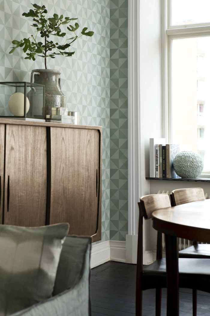 "Elements for soft Swedish modern: aqua wallpaper, smoked oak, natural light, aqua grey upholstery. Wallpaper ""Trapez 2"" by Arne Jacobsen at Borås Tapeter."