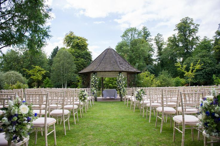 outdoor ceremony of a military wedding at Chippenham Park in Suffolk