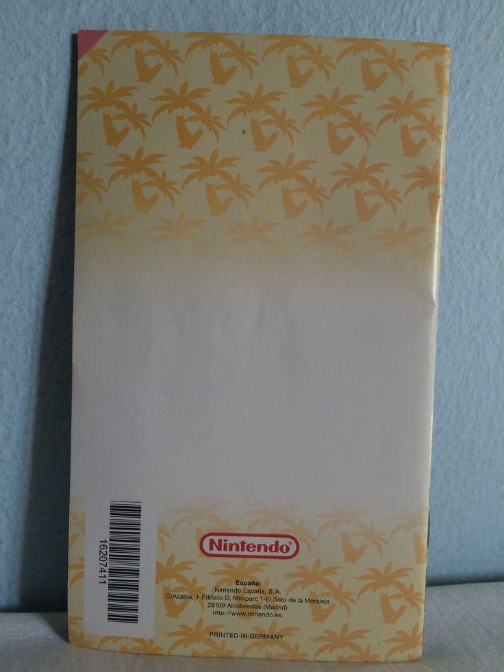 Super Mario Sunshine manual behind.