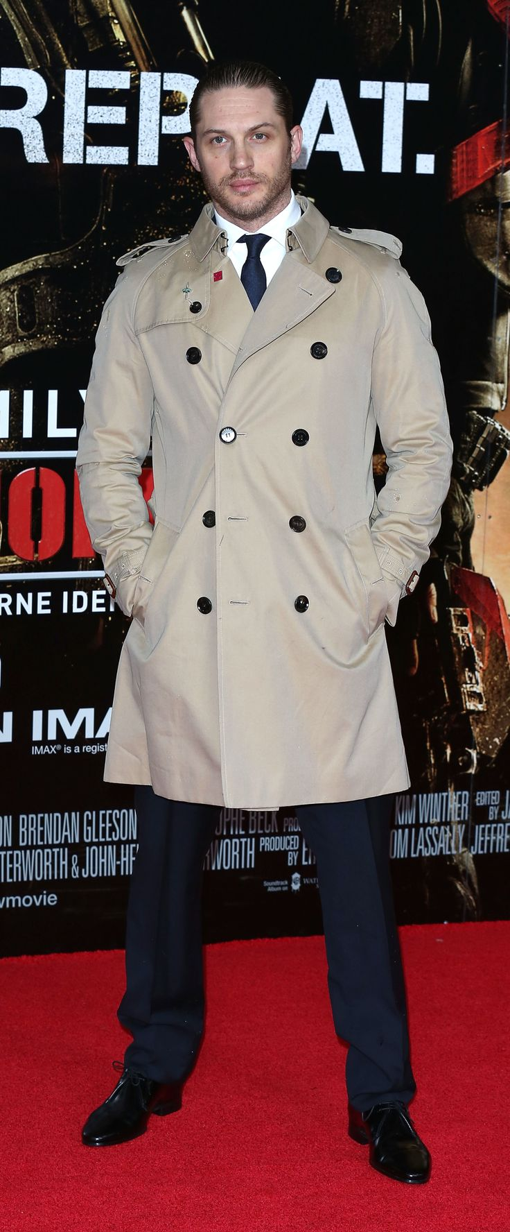 British actor Tom Hardy wearing a Burberry trench coat at the UK premiere of Edge Of Tomorrow in London