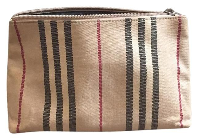 Burberry Beige Striped Clutch. Get the trendiest Clutch of the season! The Burberry Beige Striped Clutch is a top 10 member favorite on Tradesy. Save on yours before they are sold out!