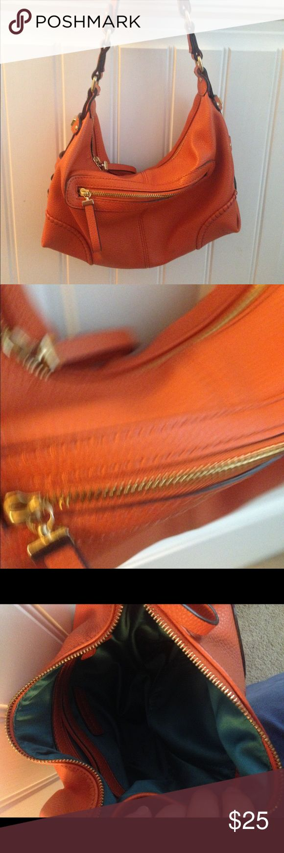 Kate Landry Orange Shoulder Bag VGUC Great fall color! Sports fans or fall color enthusiasts!! Lined with teal and has gold accent hardware. No major flaws, but was used  several times. Pic on shoulder to show size. Hobo style Kate Landry Bags