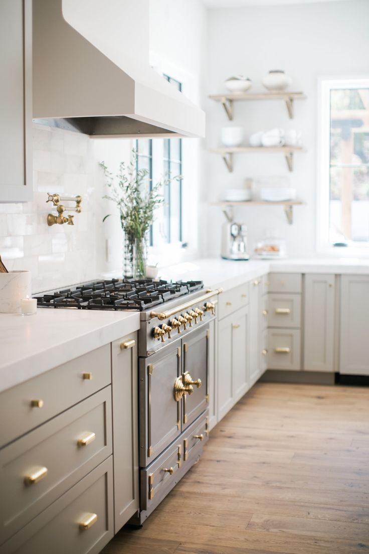 Light Gray Cabinets With Gold Hardware Vintage Range Open Shelving Next To Sink Pot Filler L In 2020 Light Grey Kitchens Kitchen Design Light Grey Kitchen Cabinets