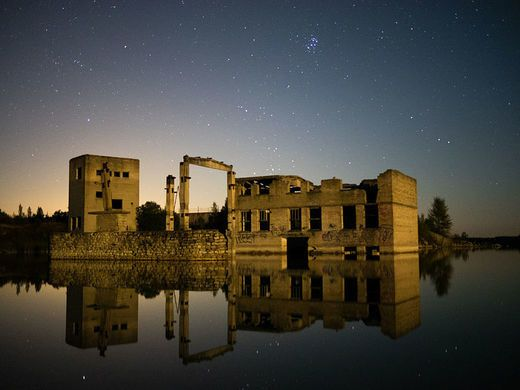The ruins of an Estonian prison are drowning in the quarry lake where the convicts were once forced to work.