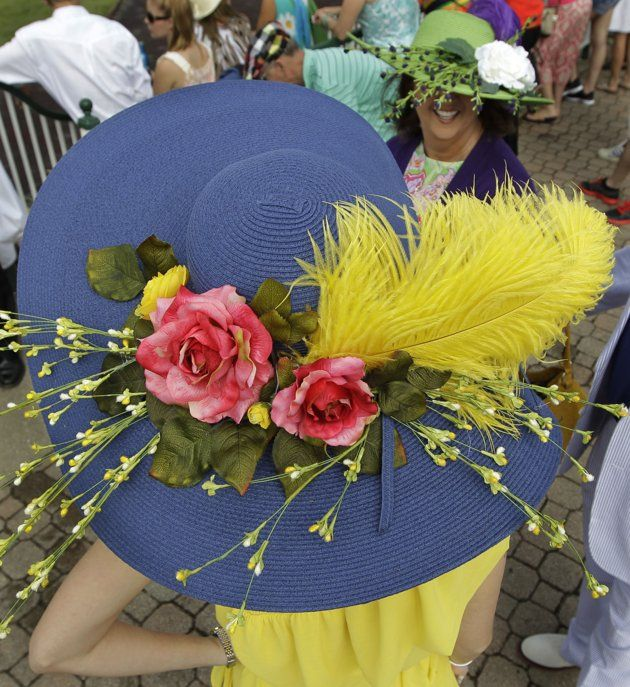 Kimberly Scott, left, from Albany, Ga., chats with a friend in the paddocks before the 138th Kentucky Derby horse race at Churchill Downs, Saturday, May 5, 2012,