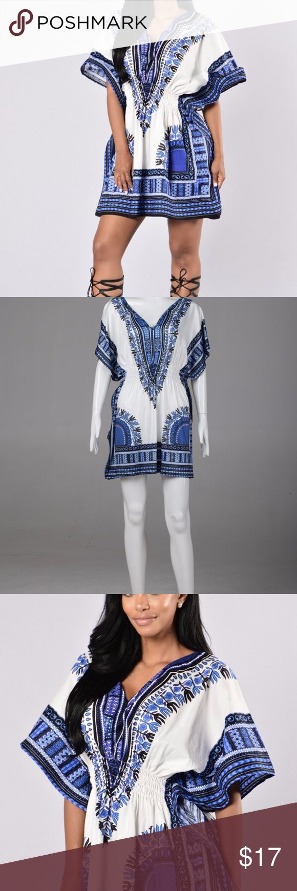 AFRICAN DASHIKI SHIRT, LARGE SIZE THIS IS A LARGE SHIRT VERY BEAUTIFUL. SPANDEX ELASTIC FABRIC THEREFORE CAN FIT EXTRA LARGE SIZE AS WELL  CAN BE WORN WITH LEGGINGS Tops Tees - Short Sleeve
