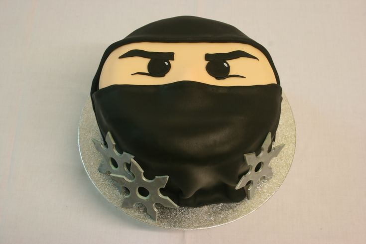 Ninja Cake - A ninja cake with silver throwing stars.  Inspired by KakkuKatristas Ninjago cake.