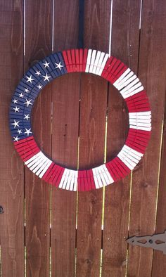 Fourth of July / American flag wreath - wreath frame, clothes pins, spray paint & star stickers