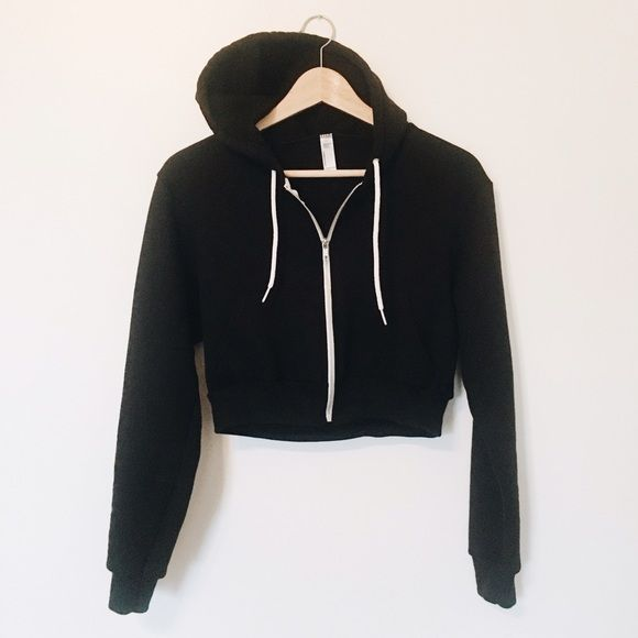 American Apparel Cropped Flex Fleece Zip Hoodie Only worn 1x, like new. Pairs well with high waisted pants/jeans or with athleisure gear. Fitted zip-up hoodie with kangaroo pocket, drawstring hood & unique cropped length. Constructed from extra soft & durable flex fleece. 50% polyester/50% cotton fleece. Metal zipper. Hooded with white finish polyester drawcord American Apparel Tops Sweatshirts & Hoodies