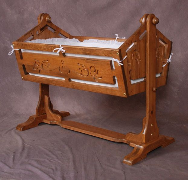 A Beautifully Carved Wooden Cradle Maurice Had Traded For With One Of His Finest Paintings