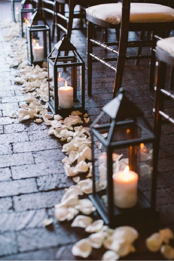 Aisle Lanterns: Could use the reception center piece lanterns and then get them moves to the reception venue. Add some rose petals for softness.