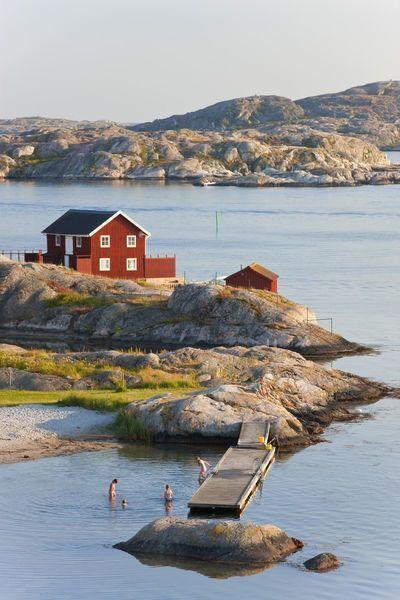 Bathing in sea, Skarhamn on island of Tjorn, Bohus…