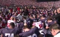 Ron Brown praying before the Penn St-Nebraska football game.