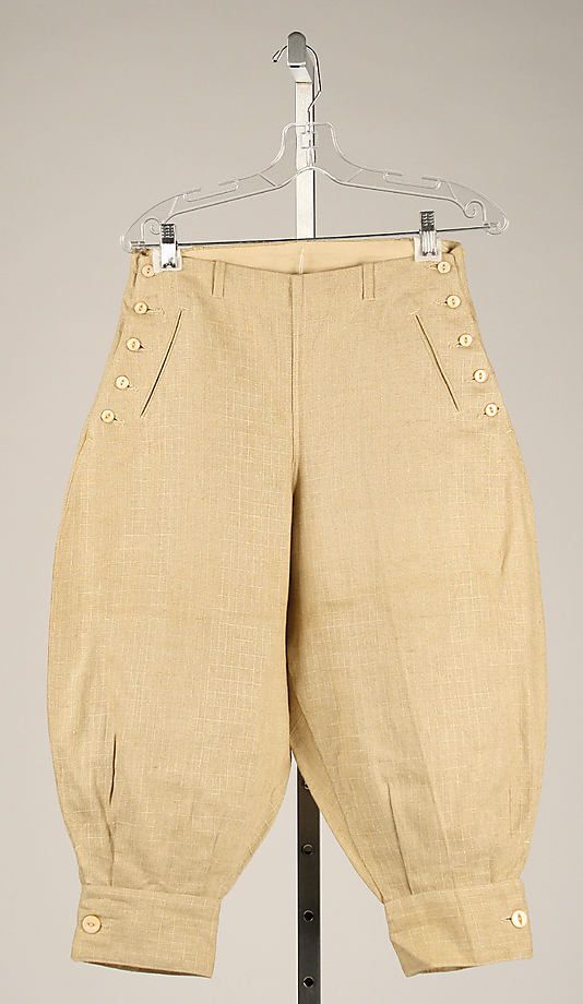 Knickerbockers: men's sportswear garment, pants cut with loose legs and belted into a hand that buckled just below the knee, worn for sports