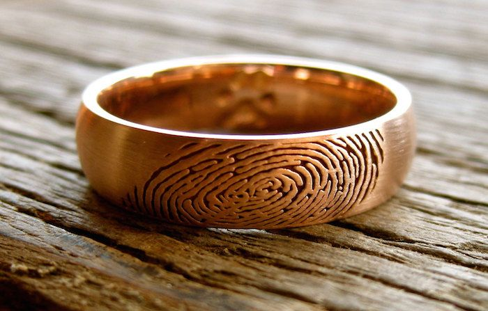 One of a kind stamped fingerprint wedding ring by AdziasjewelryAtelier via etsy. #stampedring #weddingrings