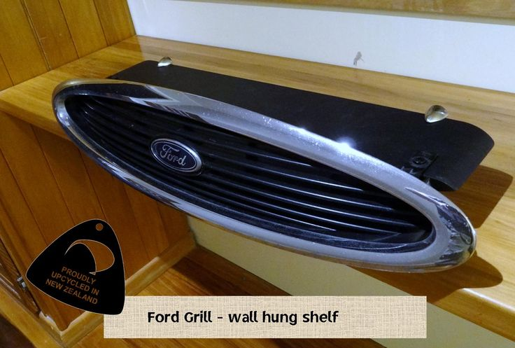 Up-Cycled ford grill. perfect for displaying your ford collectibles. Solid Industries, royal art furniture, upcycle