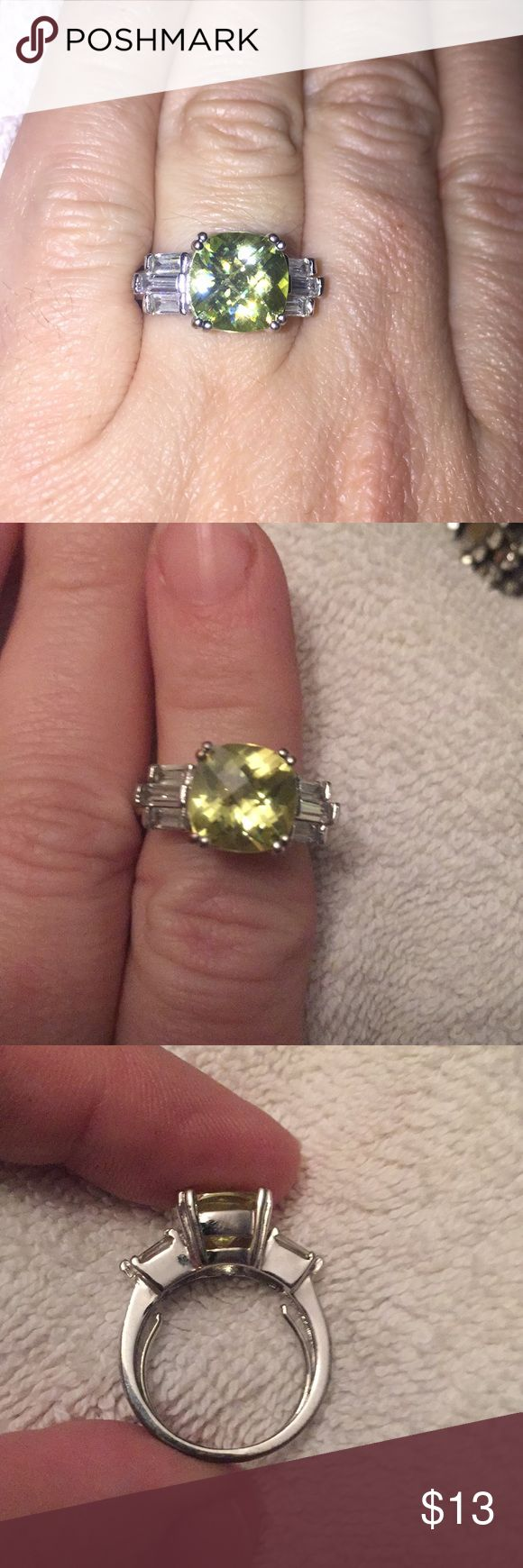 Peridot Ring Ladies  Peridot Cushing cut stone with cz baguette accent stones.  ONE SIZE FITS MOST. 💍💎 Jewelry Rings