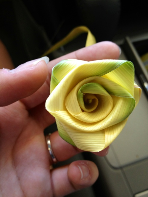 Rose made from a palm leaf.