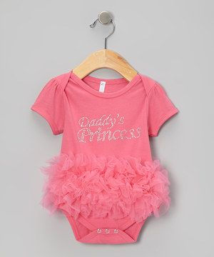 With rows of fluffy ruffles and a sweet sparkly message, this bodysuit blends girly glamour and baby-friendly functionality. Bottom snaps and a lap neck mean it's easy to change, so sweeties can get on with their fancy-filled day.