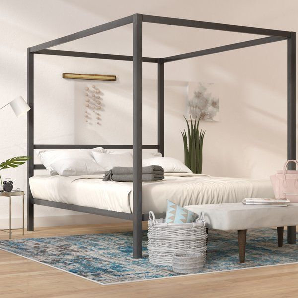 A Streamlined Contemporary Update On A Traditional Bedroom Staple This Blanford Queen Canopy Bed Anchors Your Mast Canopy Bed Frame Queen Canopy Bed Furniture