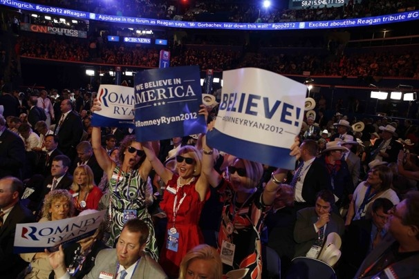 Kathy Noble, left, Ginger Howard and Melanie Crozier of the Georgia delegation hold up posters at the Republican National Convention.  Lucian Perkins / For The Washington Post