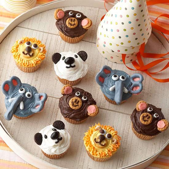 Animal birthday cupcakes - love the pretzel elephant ears!