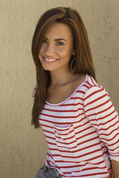 Demi Lovato. Love her hair color and makeup! This is what I'm doing when I'm over the red in my hair for sire