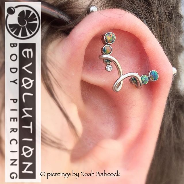 Healed #industrialpiercing with #opal and #titanium jewelry by #anatometal with a bit of custom bending