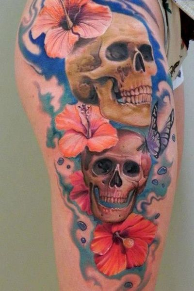How lovely those skulls with flowers and butterflies on it.. #ILOVETATTOOSINDEED