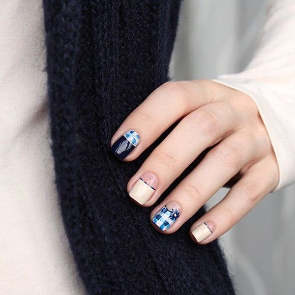 This chic and fun design uses different shades of blue for a plaid look. It's combined with a beige nail polish to make it look more subtle.