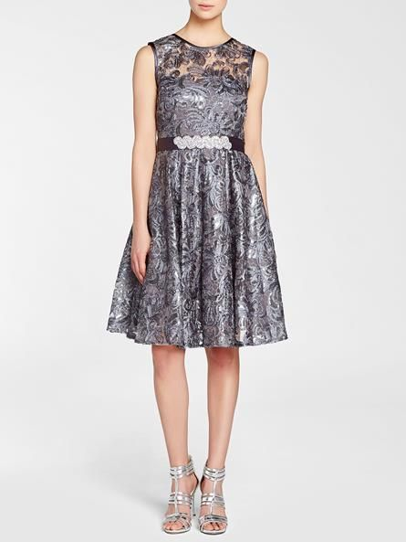 Laura. Scoop neck. Sleeveless. Sheer illusion yoke. All-over soutache with sequin detailing. Ribbon belt with bead