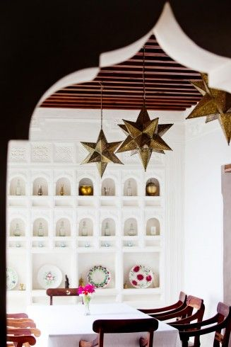 Brass star lights in a holiday house in the Lamu Archipelago, Kenya.