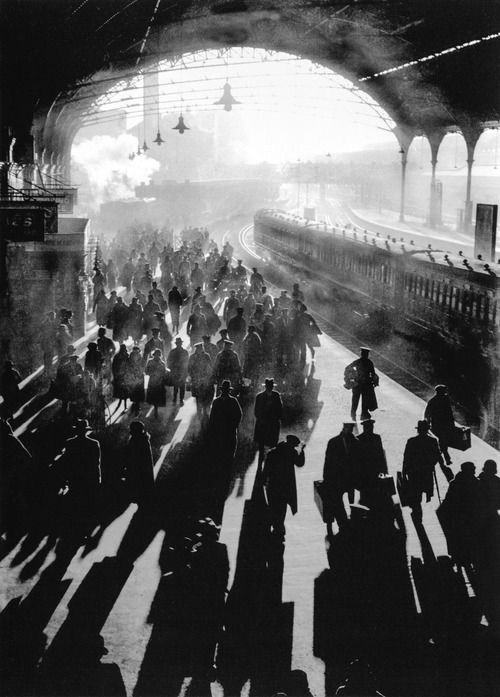 Unknown Photographer, a spot of december sun filtering onto the platform of Victoria Station, 1934  From London: Portrait of a city by Reuel Golden; p. 164-165