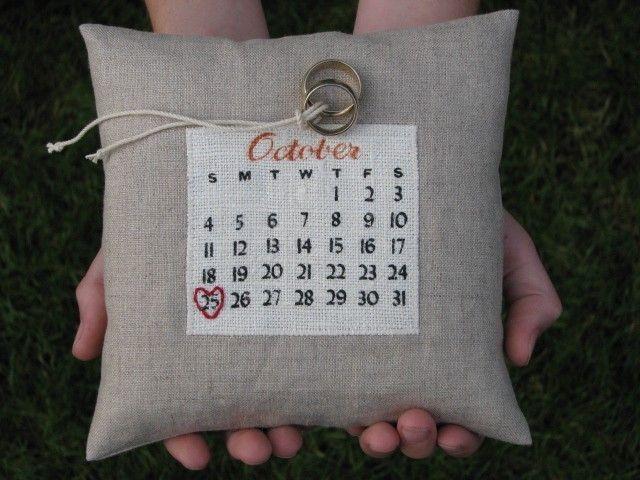 a custom calendar ring pillow... choose your date. $38.00, via Etsy.