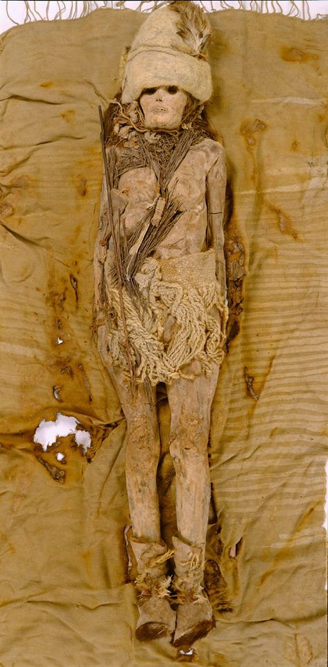 Here is a full-length image of one of the 3,500-year-old mummies buried in China's Taklamakan Desert with the earliest known pieces of cheese.   http://www.archaeology.org/news/1858-140226-china-cheese-herding