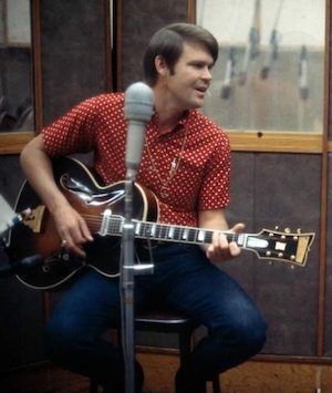 Glen Campbell built a special relationship with his British fans, but he had to work on it. In the US, his long apprenticeship had culminated in a breakthrough year in 1967, but it was February 1969 before he first appeared in the UK singles chart, with the irresistible 'Wichita Lineman.' Almost another year went by before he made the album survey for the first time, as he finally did on 31 January 1970 with Glen Campbell Live.