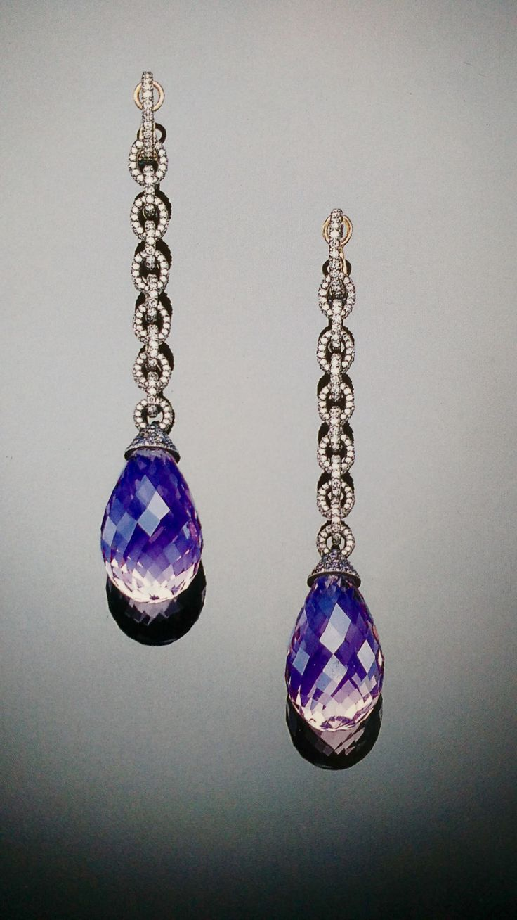 """JAR Paris. A PAIR OF RARE AMETHYST BRIOLETTE, DIAMOND AND SAPPHIRE EAR-PENDANTS, BY JAR. The diamond-set links suspending large briolette amethysts, with pavé-set sapphire caps,in the manner of """"the 18th and 19th centuries re-invented by JAR"""", quoting Marie-Hélène,the late Baroness Guy de Rothschild. Price Realized $106,651 / Estimate $28,335 - $37,780. The imagination of Joel Arthur Rosenthal, known to his followers as JAR, seems without limits. One of the most celebrated and exclusive…"""