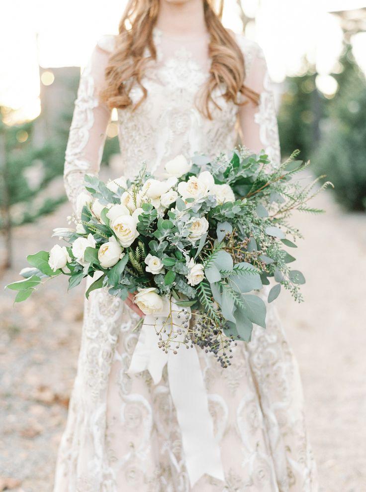 Photography: http://laurenfairphotography.com | Floral design: http://www.blvly.com | Ceremony venue: http://www.shopterrain.com/ | Suit: http://www.asos.com/ | Venue: http://www.shopterrain.com | Read More: https://www.stylemepretty.com/2017/12/25/romantic-and-cozy-holiday-inspiration/